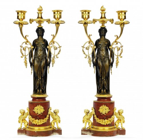 A pair of Louis XVI twin-light candelabra