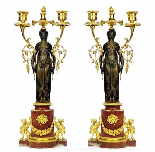 A pair of Louis XVI twin-light candelabra