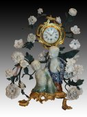 "A Chinese porcelain and gilt bronze ""aux Magots"" clock"