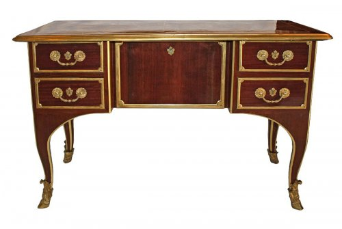 A Louis XIV ormolu-mounted amaranth Bureau de Changeur