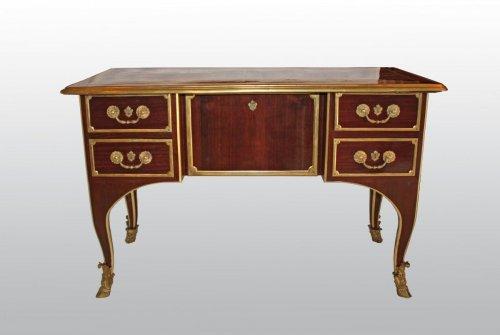 A Louis XIV ormolu-mounted amaranth Bureau de Changeur -