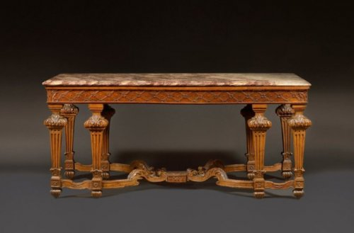 A large Louis XIV natural wood Table Console