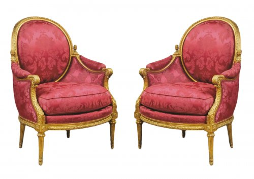 "A pair of Louis XVI Bergeres ""aux Pommes de Pins"" attributed to Jean-Baptis"