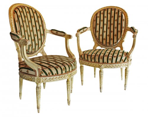 "A pair of Louis XVI ""en cabriolet"" Armchairs"