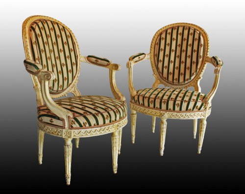 "Seating  - A pair of Louis XVI ""en cabriolet"" Armchairs"