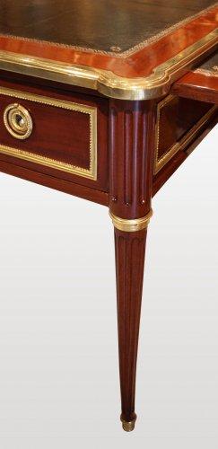 Furniture  - A Louis XVI ormolu-mounted mahogany Bureau Plat by Georges Kintz