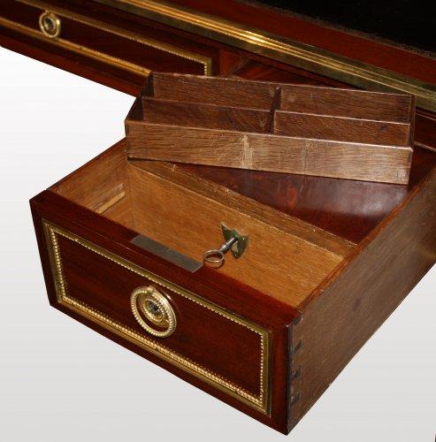A Louis XVI ormolu-mounted mahogany Bureau Plat by Georges Kintz -
