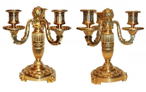 A pair of Louis XVI ormolu three-light Candelabra.