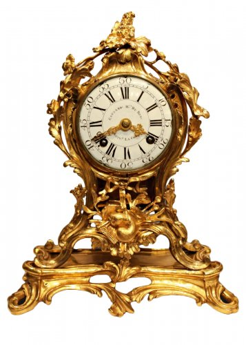 A Louis XV ormolu-mounted mantel clock by Edme-Jean Causard
