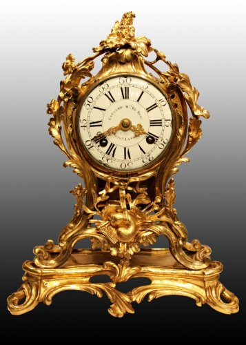 A Louis XV ormolu-mounted mantel clock by Edme-Jean Causard - Louis XV