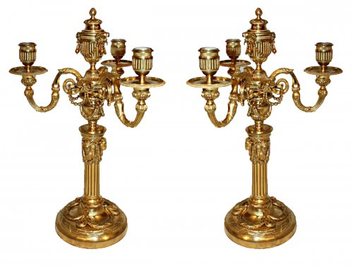 A pair of Louis XVI ornmolu four-light Candelabra