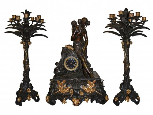 An important and rare patinated and ormolu bronze Garniture by Wallart à