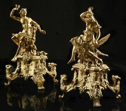 Pair of Louis XIV ormolu Chenets with figures of Ganymede and Aegina