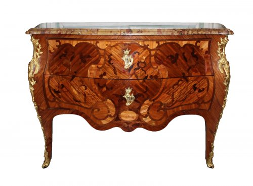 A Louis XV floral marquetry Commode