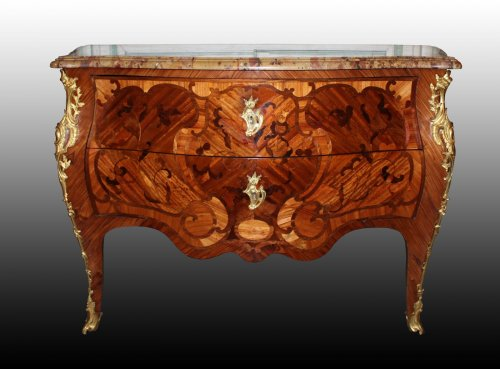 A Louis XV floral marquetry Commode -