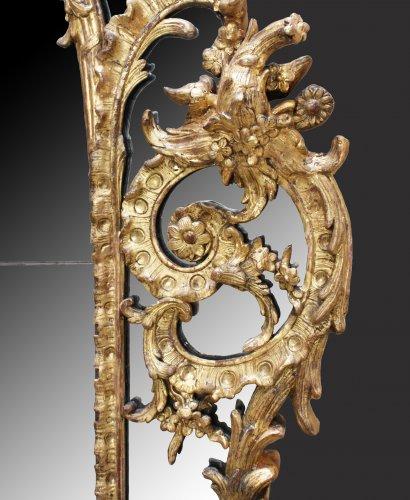 "Mirrors, Trumeau  - A Regence giltwood Mirror ""à Parecloses"""