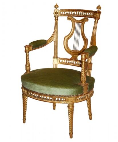 A set of four Louis XVI giltwood  Fauteuils à dossier Lyre