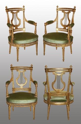 A set of four Louis XVI giltwood  Fauteuils à dossier Lyre -