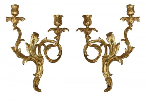 A pair of Louis XV ormolu two-branch wall-Lights