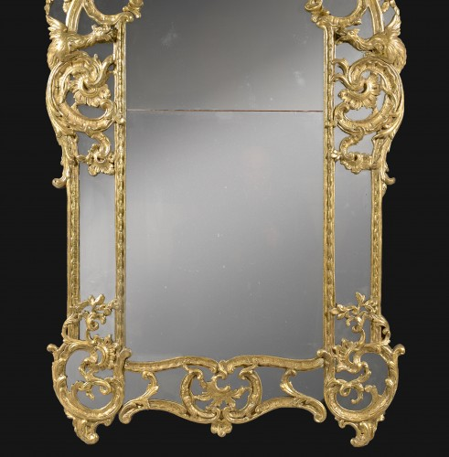 "Mirrors, Trumeau  - A Regence / Louis XV carved and giltwood Mirror ""aux Chimères"""