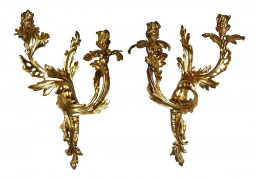 A pair of Louis XV ormolu twin-branch wall-Lights