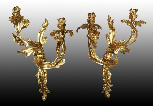 A pair of Louis XV ormolu twin-branch wall-Lights -