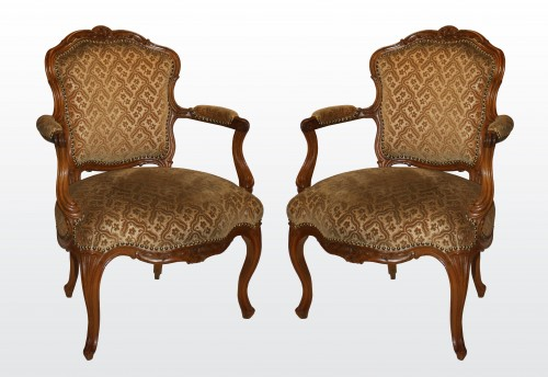 "A set of six Louis XV Fauteuils ""en Cabriolet"" by Nogaret à Lyon -"