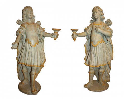 A pair of baroque  painted Torcheres