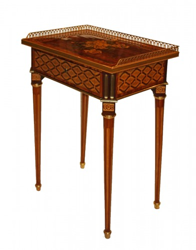 A Louis XVI ormolu-mounted marquetry Table-en-Chiffonnière by Mathieu-Guill