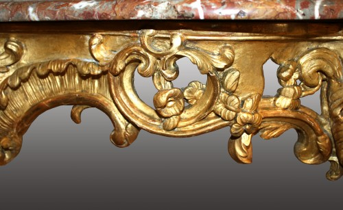 An important Louis XV  giltwood Console-Table -