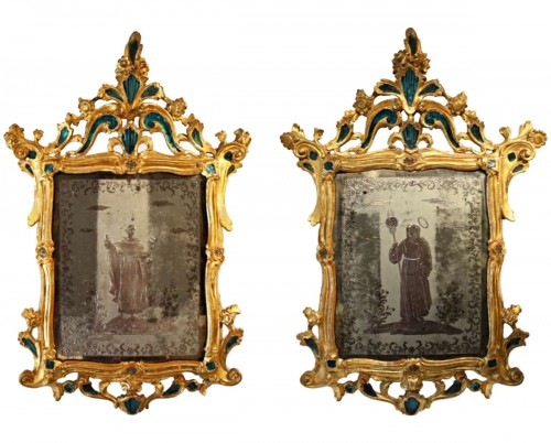 A pair of Glass-mounted 18th century Giltwood Mirrors