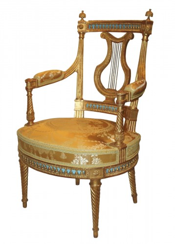 A set of four Louis XVI giltwood  Fauteuils à dossier Lyre