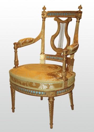 A set of four Louis XVI giltwood  Fauteuils à dossier Lyre - Seating Style Louis XVI
