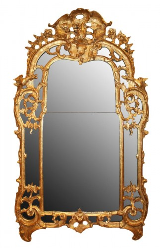 A Regence giltwood Mirror 'aux Dragons'