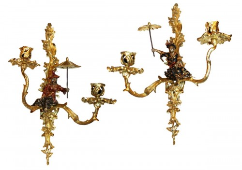 A pair of Louis XV lacquered and giltbronze twin-branch wall-lights