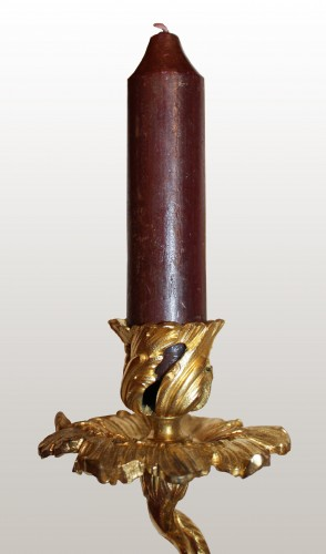 A pair of Louis XV lacquered and giltbronze twin-branch wall-lights -