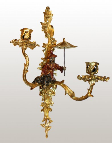 18th century - A pair of Louis XV lacquered and giltbronze twin-branch wall-lights
