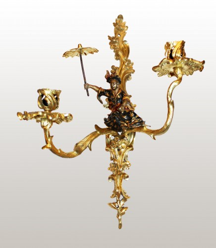 A pair of Louis XV lacquered and giltbronze twin-branch wall-lights - Louis XV