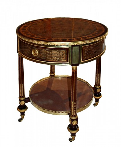 A Louis XVI ormolu-mounted veneered Gueridon