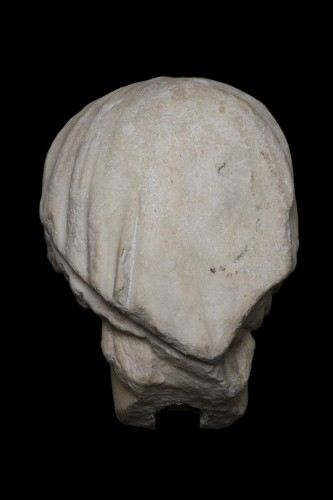 Ancient Art  - Marble head of a draped and hairdresser women, Roman