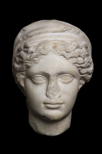 Marble head of a draped and hairdresser women, Roman -