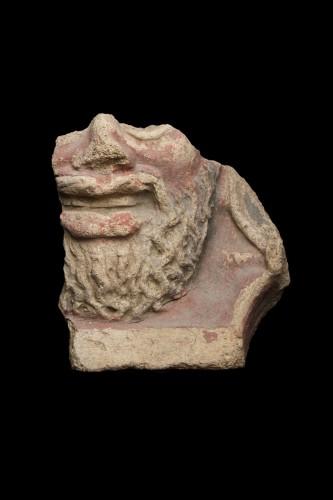Fragment of an antefix depicting a bearded man, Estruscan -