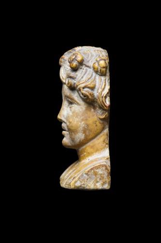 Marble herm pilar depicting a young maenad, Roman -