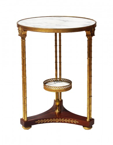 Circular neoclassical style pedestal table in bronze