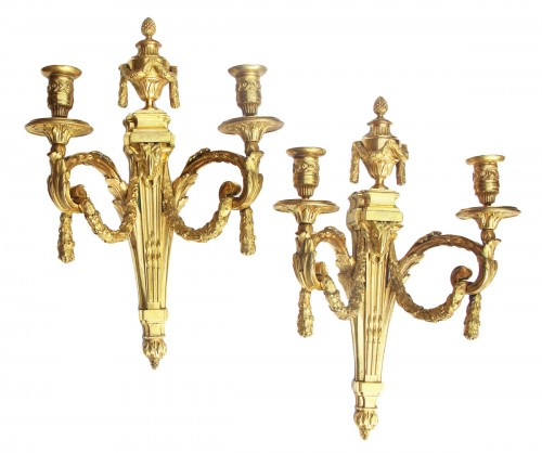 Pair of Louis XVI period wall lights with two very finely chiseled and gild