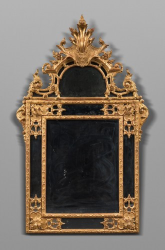 "Tall carved giltwood mirror ""à la Bérain"""