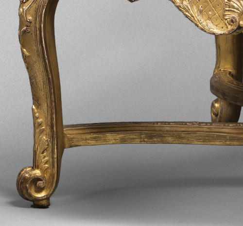 Pair of French Régence period giltwood armchairs -
