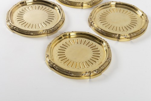 Goldsmith A.AUCOC - Suite of four 19th century vermeil coasters -