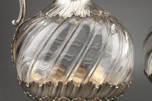 Antiquités - Goldsmith ODIOT - Pair of oblong crystal and vermeil ewers 19th century