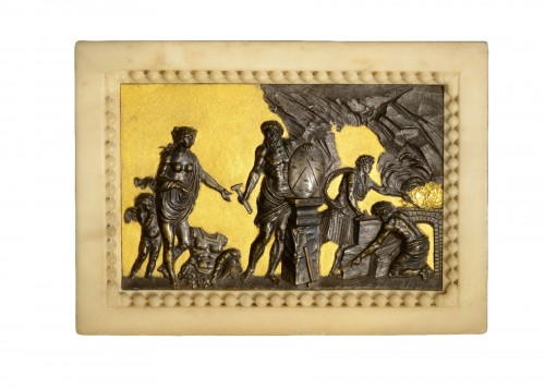 A Gilded and Patinated Bronze Relief within a Carved Marble Frame